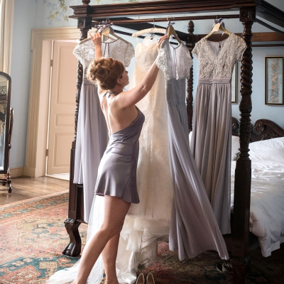 bride-getting-dressed-crowcombe-court