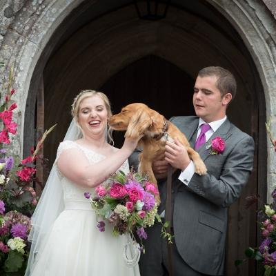 bride-groom-and-dog-chapel-entrance