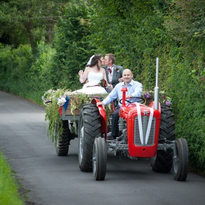 bride and groom on tractor Montacute Somerset