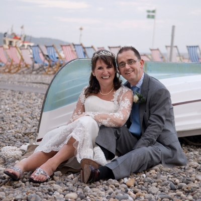 bride-groom-sat-on-beach
